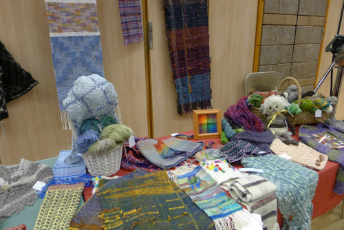 Display table and hangings, including Henriette's crackle weave sampler